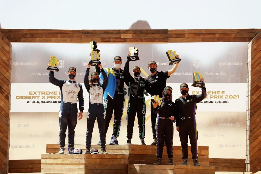 ALULA, SAUDI ARABIA - APRIL 04: Catie Munnings (GBR)/Timmy Hansen (SWE), Andretti United Extreme E, 2nd position, Molly Taylor (AUS)/Johan Kristoffersson (SWE), Rosberg X Racing, 1st position, Nico Rosberg, founder and CEO, Rosberg X Racing, and Cristina Gutierrez (ESP)/Sebastien Loeb (FRA), X44, 3rd position, on the podium during the Desert X-Prix at AlUla on April 04, 2021 in AlUla, Saudi Arabia. (Photo by Sam Bloxham / LAT Images)